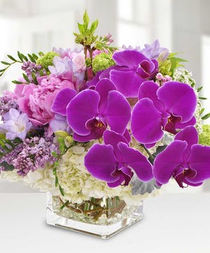 A luxurious French-inspired design, highlighted by gorgeous orchids.