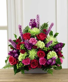 Express your sympathy with color, texture and floral artistry!