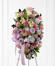 A soft and serene arrangement that elegantly honors the life of the deceased.