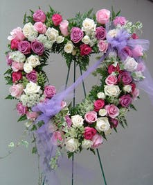 Pastel pink and lavendar roses adorn this heart
