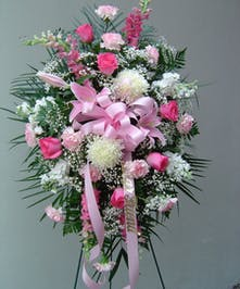 Pink and White flowers are arranged in this elegant spray.