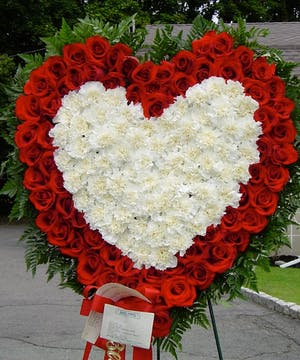 A simple combination of red roses and white carnations express your most deep feelings