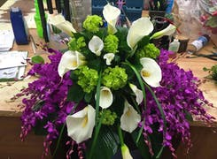 Lovely purple, green and white flowers in a large arrangement