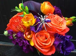 A vibrant orange, purple and yellow bouquet