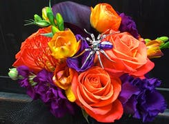 A vibrant orange, purple and yellow bouquet